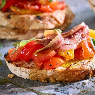 Garlic toast with roasted peppers and anchovies